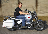 Ewan McGregor on white Moto Guzzi California Vintage