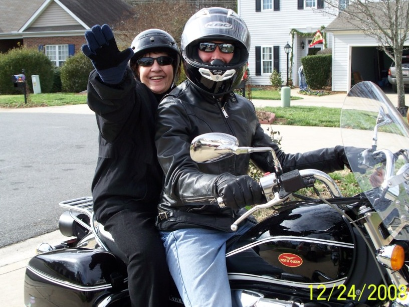 grandmother riding on Moto Guzzi motorcycle