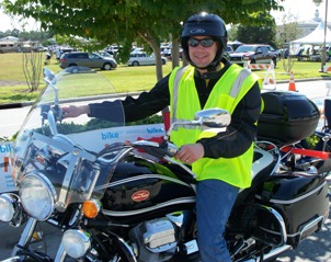 John at Sunset Beach Finish 2012 on Moto Guzzi California motorcycle for MS Breakaway to the Beach
